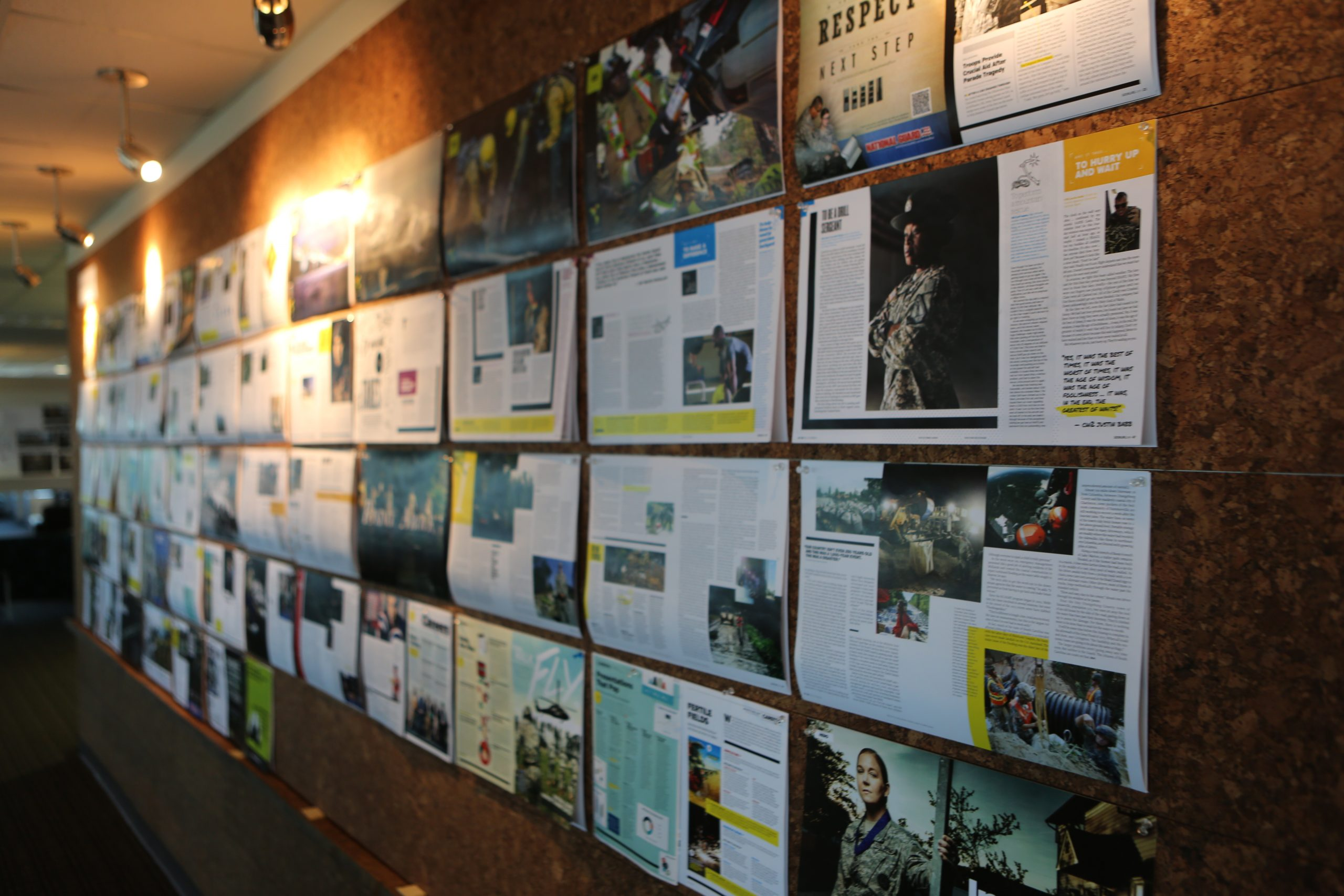 iostudio office showing GX magazine print outs laid out on a cork board wall