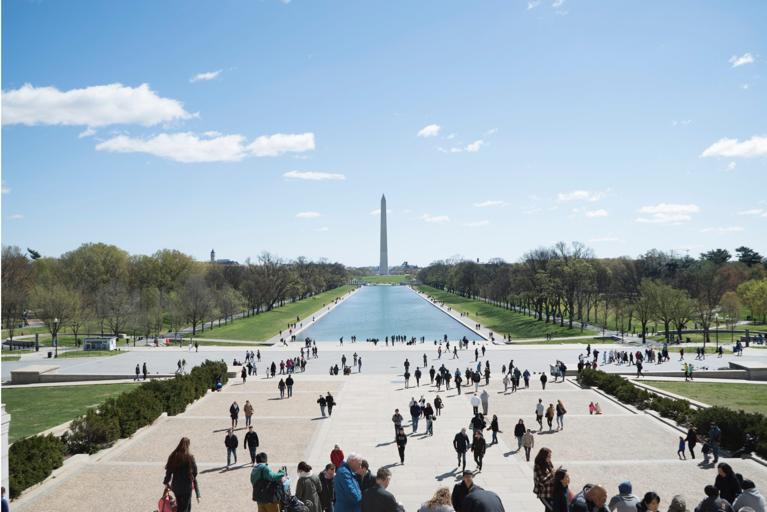 Washington Monument view with people surrounding it