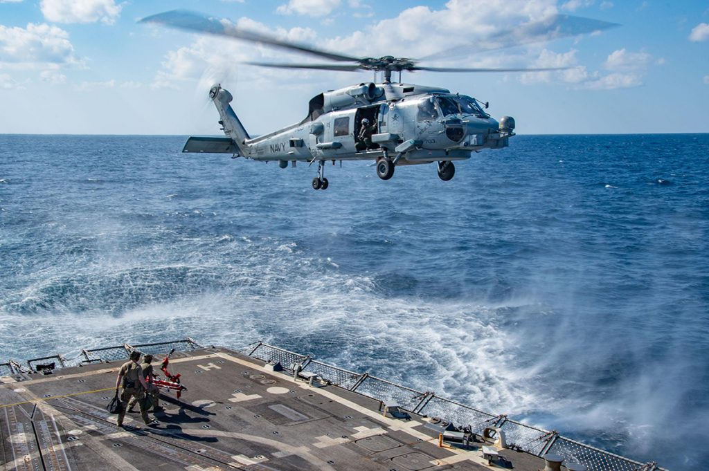 Navy helicopter landing on ship